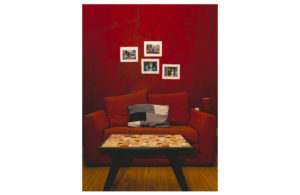 beautifull red couch with red wall decoration in casa maribel conexion gdl